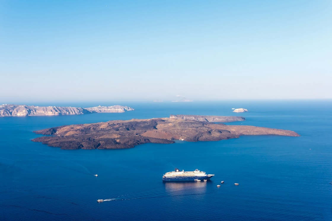 'Nea Kameni volcanic island in Santorini Greece with ships in front photographed from a high point of view' - Σαντορίνη
